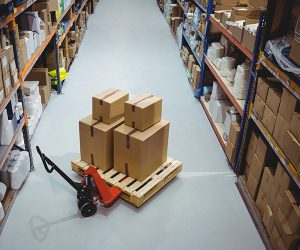 Warehouse shelves with inventory on forklift